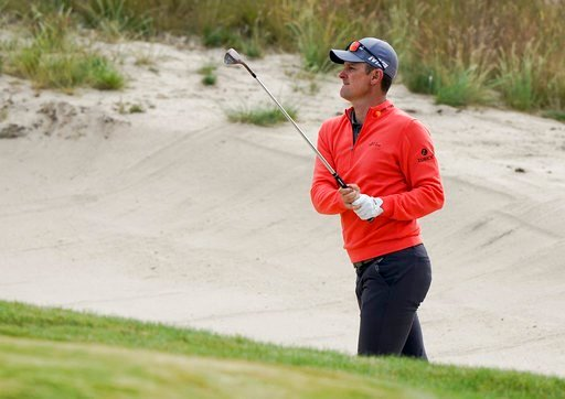 (AP Photo/Carolyn Kaster). Justin Rose, of England, hits out of a bunker on the 11th hole during a practice round for the U.S. Open Golf Championship, Wednesday, June 13, 2018, in Southampton, N.Y.