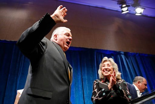 (AP Photo/John Locher). Clark County Commission Chair and Democratic gubernatorial candidate Steve Sisolak walks onstage at an election night party, Tuesday, June 12, 2018, in Las Vegas.