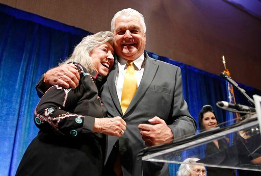 (AP Photo/John Locher). Clark County Commission Chair and Democratic gubernatorial candidate Steve Sisolak, right, embraces Rep. Dina Titus, D-Nev., at an election night party, Tuesday, June 12, 2018, in Las Vegas.