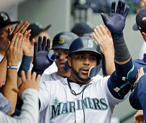 (AP Photo/Ted S. Warren). Seattle Mariners' Nelson Cruz is greeted in the dugout after hittng a two-run home run during the third inning of a baseball game agains the Los Angeles Angels, Wednesday, June 13, 2018, in Seattle.
