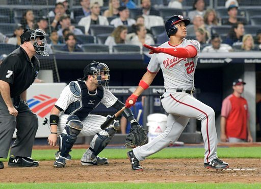 (AP Photo/Bill Kostroun). Washington Nationals' Juan Soto watches his home run in front New York Yankees catcher Austin Romine (28) and umpire Brian O'Nora uring the seventh inning of a baseball game Wednesday, June 13, 2018, at Yankee Stadium in New Y...