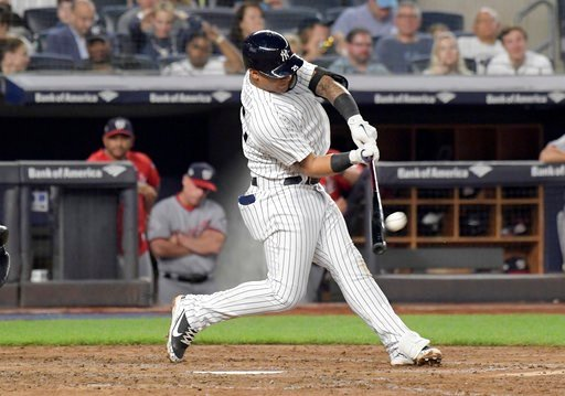 (AP Photo/Bill Kostroun). New York Yankees' Gleyber Torres hits a home run during the fifth inning of a baseball game against the Washington Nationals on Wednesday, June 13, 2018, at Yankee Stadium in New York.
