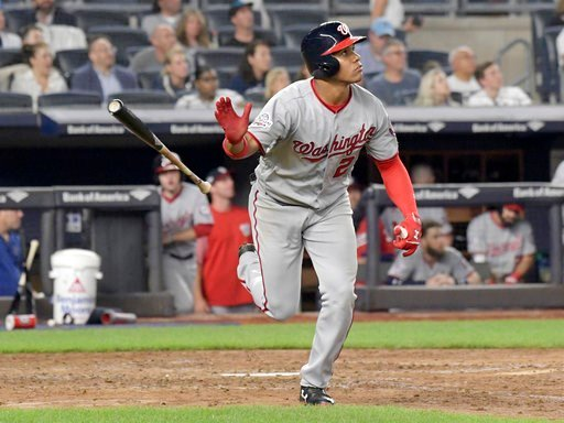 (AP Photo/Bill Kostroun). Washington Nationals' Juan Soto tosses his bat after hitting a home run against the New York Yankees during the seventh inning of a baseball game Wednesday, June 13, 2018, at Yankee Stadium in New York.