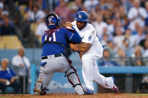 (AP Photo/Jae C. Hong). Los Angeles Dodgers' Matt Kemp, right, shoves Texas Rangers catcher Robinson Chirinos while trying to score on a single hit by Enrique Hernandez during the third inning of a baseball game, Wednesday, June 13, 2018, in Los Angeles.