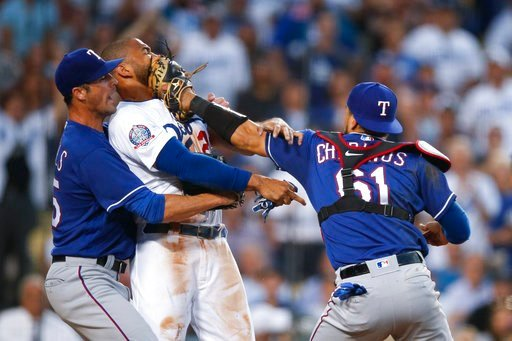 (AP Photo/Jae C. Hong). Texas Rangers starting pitcher Cole Hamels, left, restrains Los Angeles Dodgers' Matt Kemp as Kemp scuffles with Rangers catcher Robinson Chirinos during the third inning of a baseball game Wednesday, June 13, 2018, in Los Angel...
