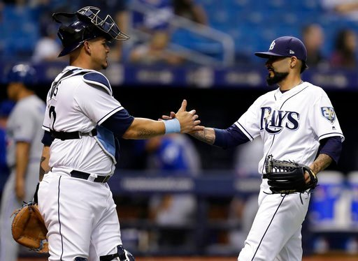 (AP Photo/Chris O'Meara). Tampa Bay Rays pitcher Sergio Romo and catcher Wilson Ramos celebrate after the Rays defeated the Toronto Blue Jays 4-1 in a baseball game Tuesday, June 12, 2018, in St. Petersburg, Fla.