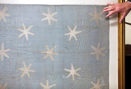 (AP Photo/Jacqueline Larma). R. Scott Stephenson discusses the Commander-in-Chief's Standard, Wednesday, June 13, 2018, at the Museum of the American Revolution in Philadelphia. The faded and fragile blue silk flag marked General George Washington's pr...