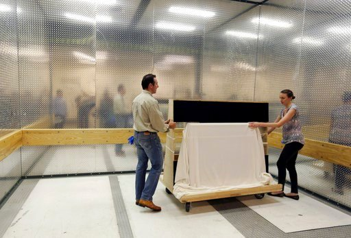 (AP Photo/Jacqueline Larma). Collections manager/registrar Michelle Moskal, right, and curator Mark Turdo move the covered Commander-in-Chief's Standard in a freight elevator to an exhibition gallery, Wednesday, June 13, 2018, at the Museum of the Amer...