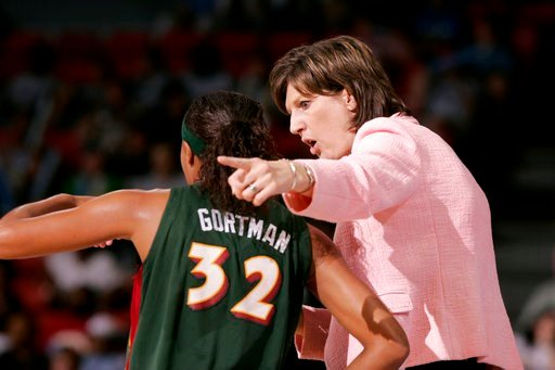 (AP Photo/Jeff Roberson, File). FILE - In this June 15, 2006, file photo, Seattle Storm coach Anne Donovan, right, talks to Shaunzinski Gortman during the fourth quarter of the team's WNBA basketball game against the Chicago Sky in Chicago. The Storm w...