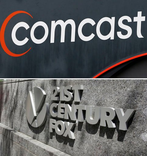 (AP Photo/File). FILE- This combo of file photos shows the 21st Century Fox sign outside of the News Corporation headquarters building on Aug. 1, 2017, in New York, bottom, and a Comcast sign on Oct. 12, 2017, in Hialeah, Fla.  Comcast is making a $65 ...