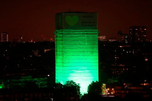 (Jonathan Brady/PA via AP). Grenfell Tower in west London is illuminated in green to mark a year since the moment the devastating fire took hold, claiming 72 lives, Thursday June 14, 2018. Thursday marks 12 months since a small kitchen fire in the high...