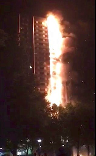 (Grenfell Tower Inquiry via AP, File). FILE - A June 14, 2017 file handout grab taken from video issued by the Grenfell Tower Inquiry, timestamped between 01.26 and 01.29, shows the fire spreading up the tower. In 2017, the residential high-rise was de...