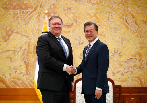(Kim Hong-ji/Pool Photo via AP). U.S. Secretary of State Mike Pompeo, left, poses with South Korean President Moon Jae-in for a photo during a bilateral meeting at the presidential Blue House in Seoul, South Korea Thursday, June 14, 2018.
