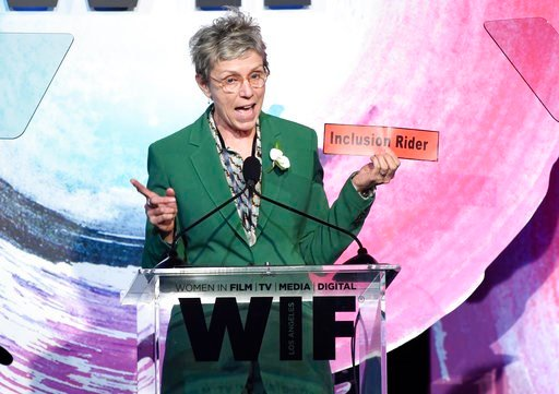 (Photo by Chris Pizzello/Invision/AP). Frances McDormand, holding a sign that says Inclusion Rider, introduces Stacey L. Smith at the Women In Film Crystal and Lucy Awards at the Beverly Hilton Hotel on Wednesday, June 13, 2018, in Beverly Hills, Calif.