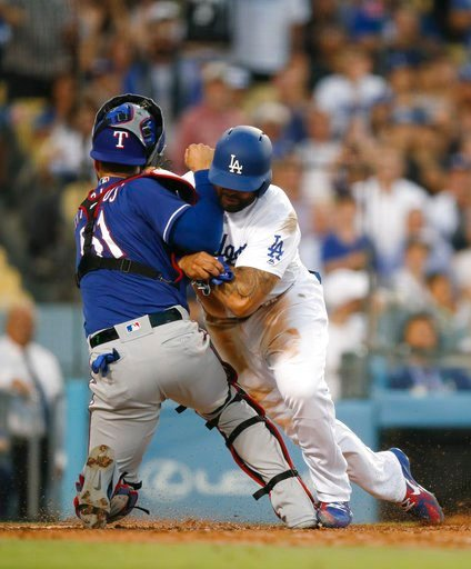 (AP Photo/Jae C. Hong). Los Angeles Dodgers' Matt Kemp, right, shoves Texas Rangers catcher Robinson Chirinos while trying to score on a single hit by Enrique Hernandez during the third inning of a baseball game Wednesday, June 13, 2018, in Los Angeles.