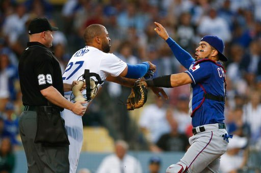 (AP Photo/Jae C. Hong). Los Angeles Dodgers' Matt Kemp, left, and Texas Rangers catcher Robinson Chirinos scuffle after Chirinos was shoved by Kemp at home plate during the third inning of a baseball game, Wednesday, June 13, 2018, in Los Angeles.