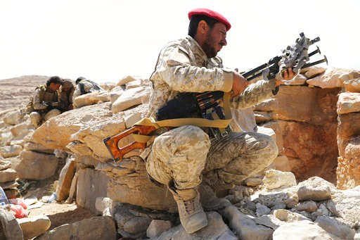 (AP Photo/Jon Gambrell, File). FILE - In this Friday, Feb. 2, 2018, file photo, a Yemeni soldier allied to the country's internationally recognized government unslings his machine gun on the outskirts of Sanaa, Yemen. Yemen's yearslong war between Shii...