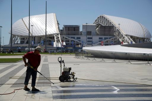 (AP Photo/Thanassis Stavrakis). A worker cleans the area in front of Fisht Stadium ahead of the 2018 soccer World Cup in Sochi, Russia, on Thursday, June 14, 2018.
