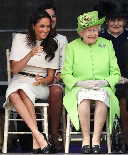 (Danny Lawson/PA via AP). Britain's Queen Elizabeth II and Meghan, the Duchess of Sussex, left, attend the opening of the new Mersey Gateway Bridge, in Widnes, north west England, Thursday June 14, 2018.