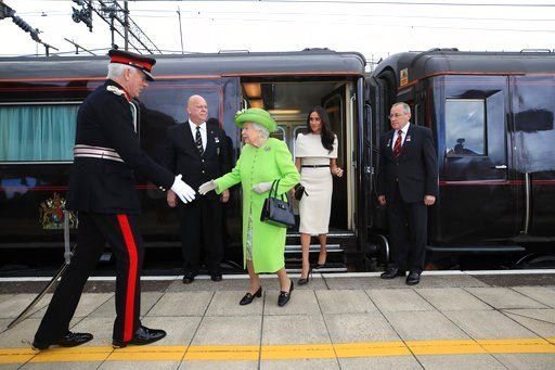 (Peter Byrne/Pool via AP). Britain's Queen Elizabeth II and Meghan, the Duchess of Sussex arrive by Royal Train at Runcorn Station, north west England, Thursday June 14, 2018.
