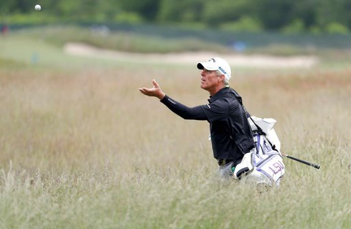 (AP Photo/Julio Cortez). Luis Gagne's caddie turns to catch a ball as he walks through the fescue during a practice round for the U.S. Open Golf Championship, Wednesday, June 13, 2018, in Southampton, N.Y.
