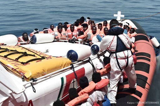"(Kenny Karpov/SOS Mediterranee via AP). This June 12, 2018 photo released Wednesday, June 13, 2018 by French NGO ""SOS Mediterranee"" shows migrants being transferred from the Aquarius ship to Italian Coast Guard boats, in the Mediterranean Sea. Italy di..."