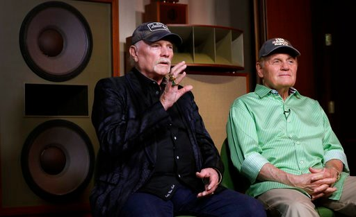 (AP Photo/Kirsty Wigglesworth). In this photo taken on Wednesday, June 13, 2018, Beach Boys musicians Mike Love, left, and Bruce Johnston, right, during an interview with Associated Press at Spiritland in London. The Beach Boys have a new CD with the R...