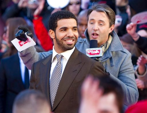 (Darren Calabrese/The Canadian Press via AP). FILE - In this March 27, 2011 file photo, Drake arrives on the red carpet at the 2011 JUNO Awards, Canada's music awards in Toronto.  Drake is having a Degrassi Community School reunion. The rapper played J...