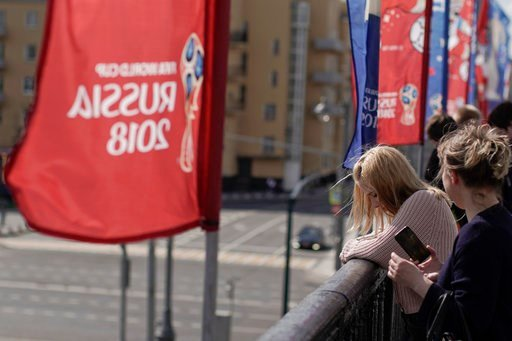 (AP Photo/Victor R. Caivano). Women look over from the Krymsky Bridge, adorned with banners of the 2018 soccer World Cup, in Moscow, Russia, Wednesday, June 13, 2018. A senior Russian lawmaker advised Russian women Wednesday to be vigilant during any r...