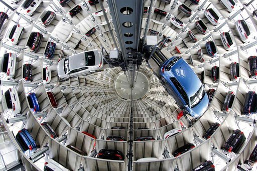 (AP Photo/Markus Schreiber, File). FILE - In this April 28, 2016 file photo Volkswagen cars are presented to media inside a delivery tower in Wolfsburg, Germany. Automaker Volkswagen says it's being fined 1 billion euros ($1.18 billion) by German autho...