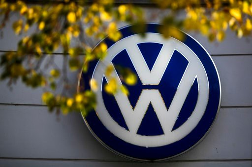 (AP Photo/Markus Schreiber, File). FILE - In this Oct. 5, 2015, file photo, the VW sign of Germany's Volkswagen car company is displayed at the building of a company's retailer in Berlin. Automaker Volkswagen says it's being fined 1 billion euros ($1.1...