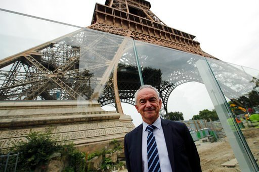 (AP Photo/Francois Mori). Bernard Gaudillere, president of the SETE, Eiffel Tower Exploitation Society poses in front of a new security bulletproof glass barrier under construction around the Eiffel Tower in Paris, France, Thursday, June 14, 2018. Pari...