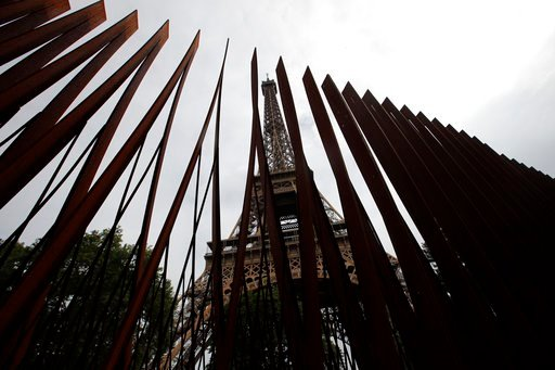 (AP Photo/Francois Mori). View of a new metal barrier under construction around the Eiffel Tower in Paris, France, Thursday, June 14, 2018. Paris authorities have started replacing the metal security fencing around the Eiffel Tower with a more visually...
