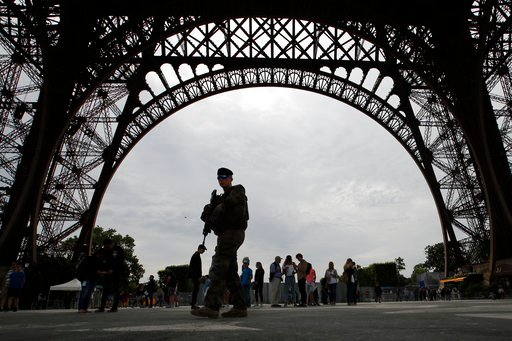 (AP Photo/Francois Mori). French soldier patrols during a press visit of the new security barriers under construction around the Eiffel Tower in Paris, France, Thursday, June 14, 2018. Paris authorities have started replacing the metal security fencing...