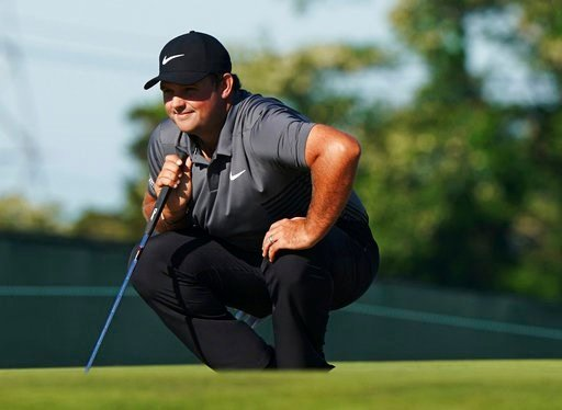 (AP Photo/Carolyn Kaster). Patrick Reed lines up a shot on the 10th green during the first round of the U.S. Open Golf Championship, Thursday, June 14, 2018, in Southampton, N.Y.
