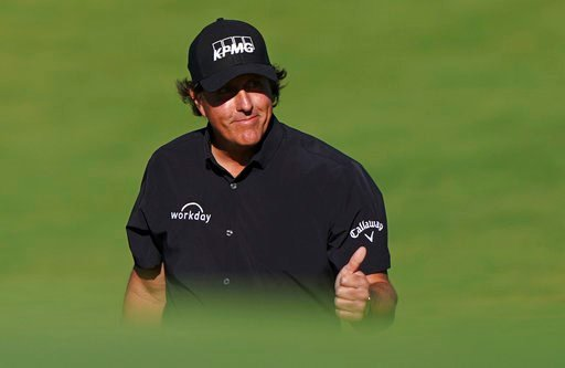 (AP Photo/Carolyn Kaster). Phil Mickelson walks down the 10th fairway during the first round of the U.S. Open Golf Championship, Thursday, June 14, 2018, in Southampton, N.Y.