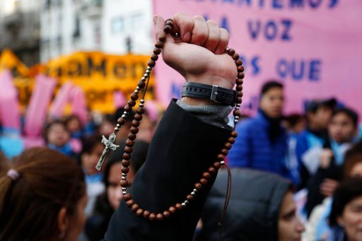 (AP Photo/Jorge Saenz). Pro-life protesters rally against a proposed law to legalize abortion, with one holding a Catholic rosary, near Congress in Buenos Aires, Wednesday, June 13, 2018. Argentina's legislature has begun debating a measure that would ...