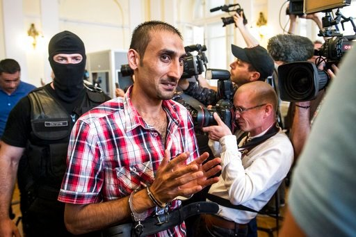 (Sandor Ujvari/MTI via AP). Prime suspect L.S. of Afghanistan attends a court hearing at Kecskemet Court of Justice in Kecskemet, 85 kms southeast of Budapest, Hungary, Thursday, June 14, 2018. The Hungarian court has sentenced four human traffickers t...