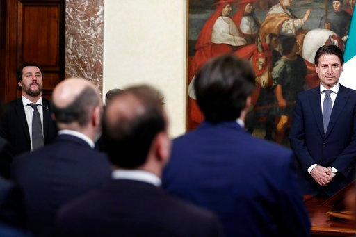 (Riccardo Antimiani/ANSA via AP). Italian Interior minister Matteo Salvini, left, and Italian Premier Giuseppe Conte, right attend the swearing-in ceremony for the new undersecretaries in Rome, Wednesday, June 13, 2018. Italy escalated its standoff wit...