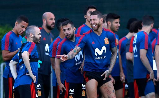 (AP Photo/Manu Fernandez). Spain's Sergio Ramos, center, jokes with his teammates during a training session of Spain at the 2018 soccer World Cup in Krasnodar, Russia, Wednesday, June 13, 2018.