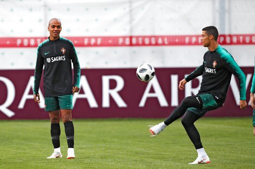 (AP Photo/Francisco Seco). Portugal's Cristiano Ronaldo, right, plays the ball next to teammate Joao Mario during the training session of Portugal at the 2018 soccer World Cup in Kratovo, outskirts Moscow, Russia, Wednesday, June 13, 2018.