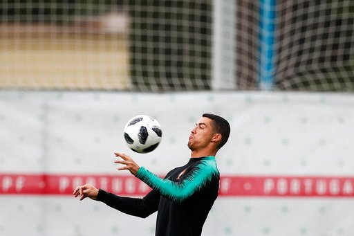 (AP Photo/Francisco Seco). Portugal's Cristiano Ronaldo controls the ball during the training session of Portugal at the 2018 soccer World Cup in Kratovo, outskirts Moscow, Russia, Wednesday, June 13, 2018.