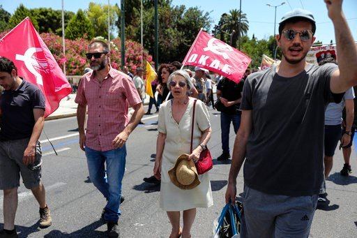 (AP Photo). Protesters chant slogans during an anti-austerity rally in Athens, Thursday, June 14, 2018. Greece and its creditors are working on reaching a final deal next week on the country exiting its international bailout this summer, the European C...