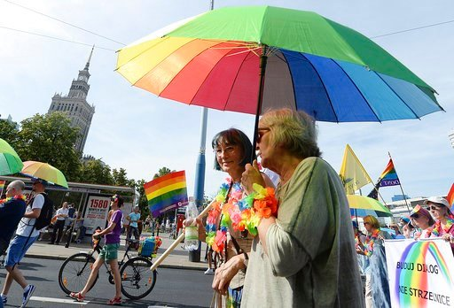(AP Photo/Czarek Sokolowski). People take part in a Gay Pride parade in Warsaw, Poland, Saturday, June 9, 2018. The pride celebrations come as LGBT activists say a conservative turn in Poland is only motivating them to fight harder for their rights, ev...