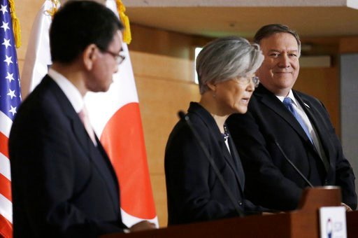 (AP Photo/Ahn Young-joon). U.S. Secretary of State Mike Pompeo, right, and Japanese Foreign Minister Taro Kono, left, listen to South Korean Foreign Minister Kang Kyung-wha during a joint press conference following their meeting at Foreign Ministry in ...