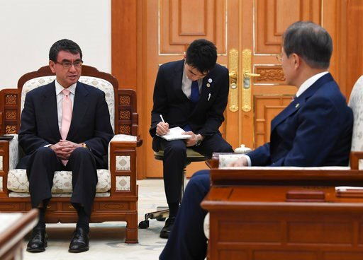 (Kim Min-hee/Pool Photo via AP). South Korean President Moon Jae-in, right, talks with Japanese Foreign Minister Taro Kono during their meeting at the presidential Blue House, Thursday, June 14, 2018 in Seoul, South Korea.