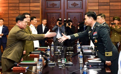 (South Korea Defense Ministry via AP). In this photo provided by South Korea Defense Ministry, South Korean Maj. Gen. Kim Do-gyun, right, tries to shakes hands with his North Korean counterpart Lt. Gen. An Ik San during a meeting at the northern side o...
