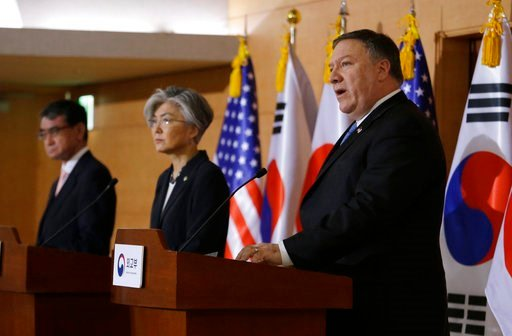 (AP Photo/Ahn Young-joon). U.S. Secretary of State Mike Pompeo, right, speaks as South Korean Foreign Minister Kang Kyung-wha, center, and Japanese Foreign Minister Taro Kono listen during a joint press conference following their meeting at Foreign Min...