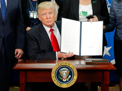 (AP Photo/Pablo Martinez Monsivais, File). FILE - President Donald Trump holds up an executive order for border security and immigration enforcement improvements after signing the order during a visit to the Homeland Security Department headquarters in...