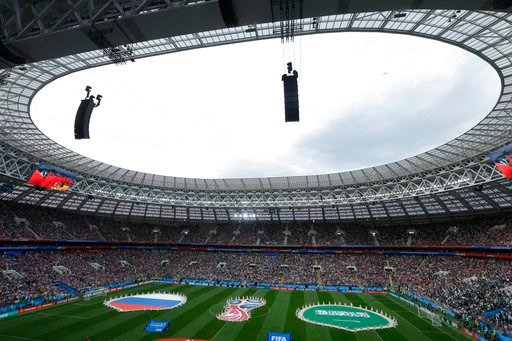 (AP Photo/Victor Caivano). Performers display the 2018 soccer World Cup logo and the colors of Russia and Saudi Arabia prior to their group A match which opens the tournament at the Luzhniki stadium in Moscow, Russia, Thursday, June 14, 2018.